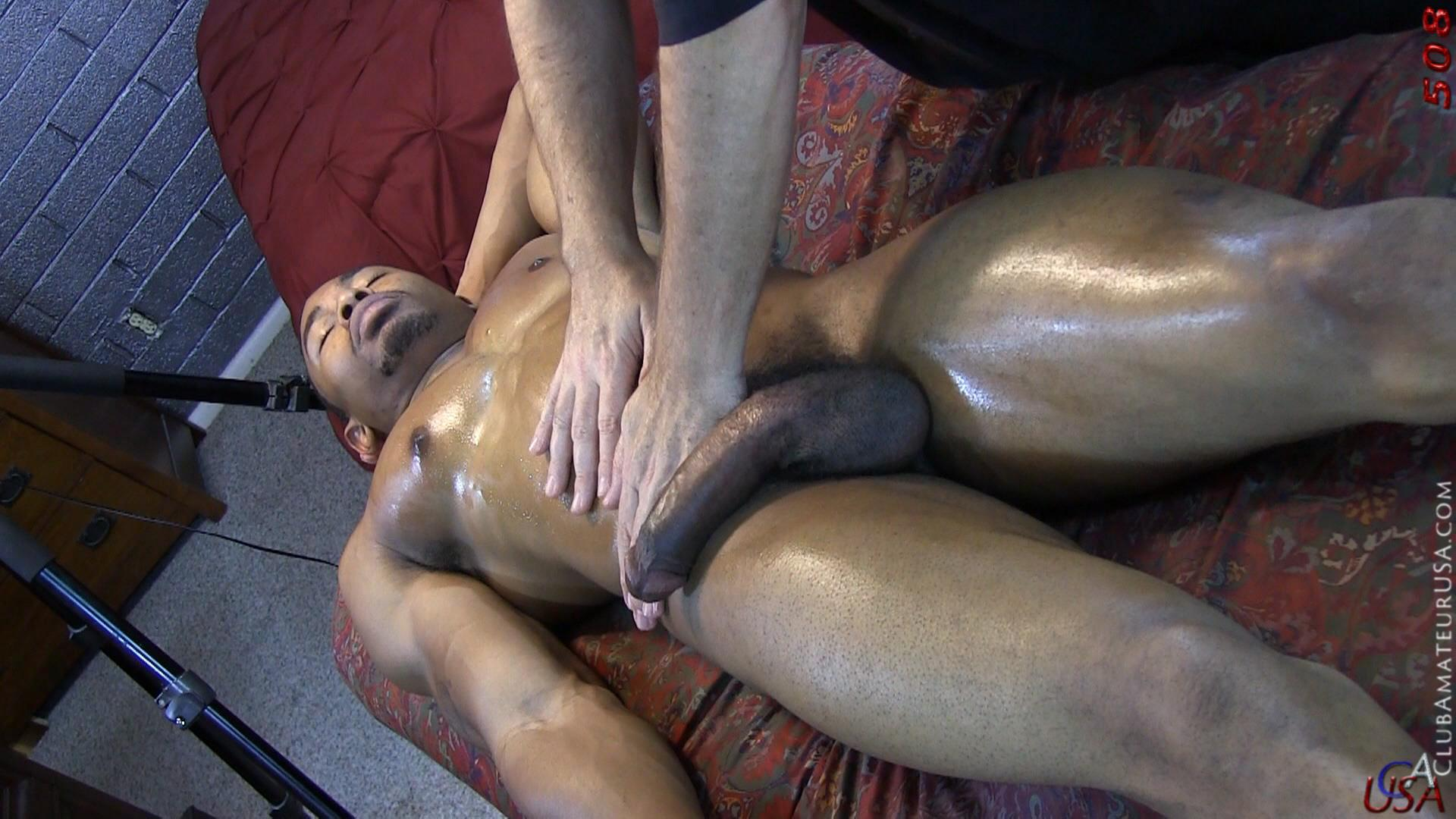 image Black guy makes massage for tight young boy